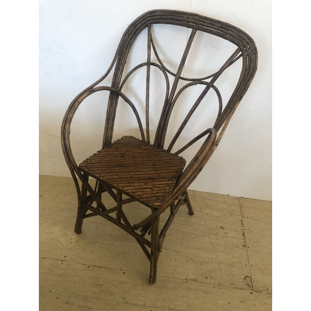 Authentic Adirondack rustic twig arm chair having beautiful workmanship and antique character. Sturdy and comfortable. arm...
