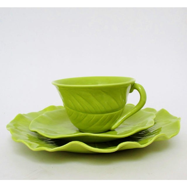 Water lily leaf-shaped porcelain tea service for 7. Set includes 7 tea cups, 7 saucers, 7 dessert plates and 1 small...