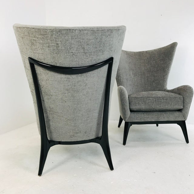These unique wing chairs truly embody Scandinavian style with the element of the wood detail across the outback. The...