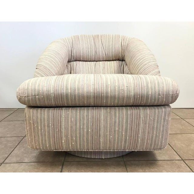 Pair of swivel lounge chairs by Directional. There are a pair of ottomans being sold separately.