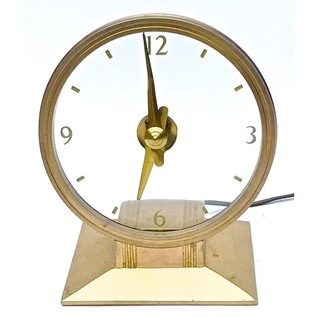 Vintage Art Deco atomic clock with Art Deco-style base. The glass face features gilt hands and numerals floating in the...