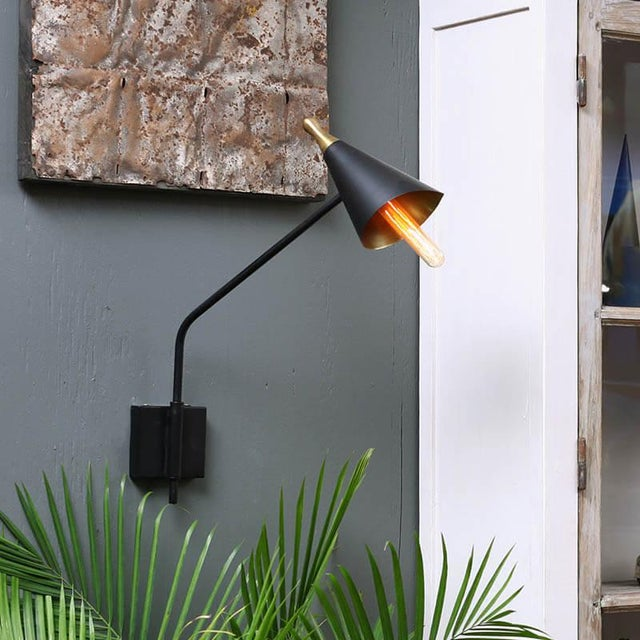 Black and gold midcentury sconce.