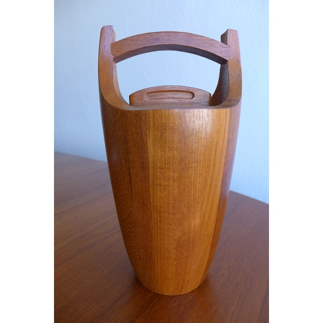 This beautiful teak ice bucket is designed by Jens Quistgaard for Dansk.