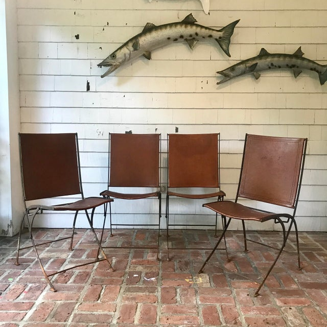 Beautiful and unique set of 4 leather and hand forged iron folding chairs. • Would be a great chair for a sunroom or...