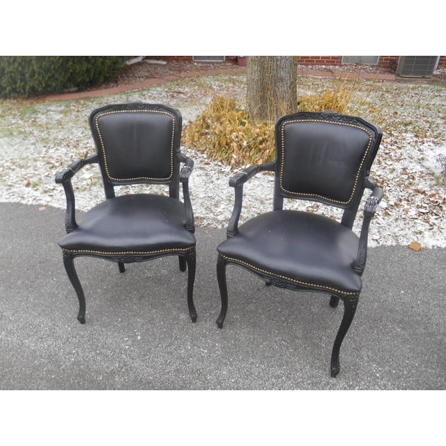 Gorgeous and quality set of vintage French Louis XV style black leather bergere chairs. These wonderful chairs are in...
