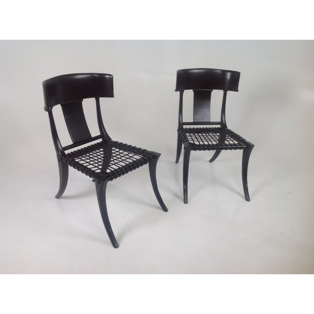 Pair of Robsjohn Gibbings style Klismos dining chairs, a pair. The chairs is made of alder . The leather cording is round....