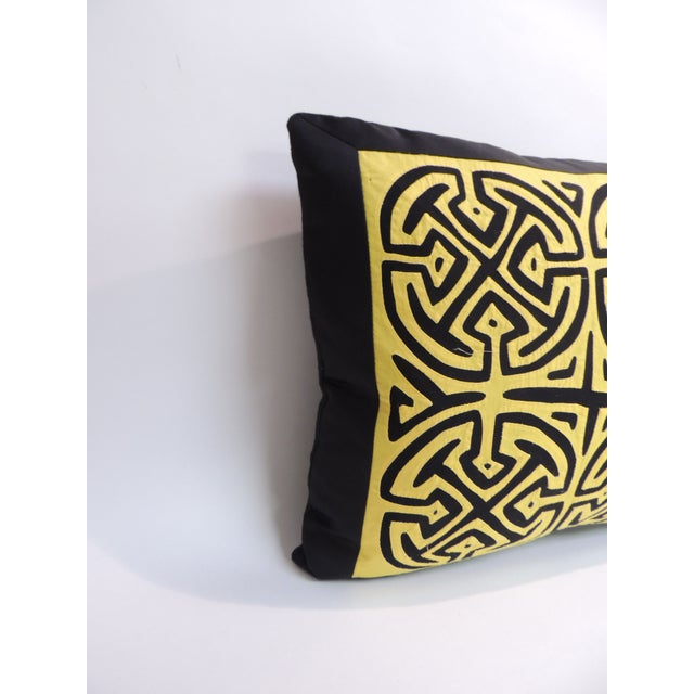 Vintage yellow and black graphic decorative pillow with cotton frame and black linen backing. The Mola fiber arts culture...