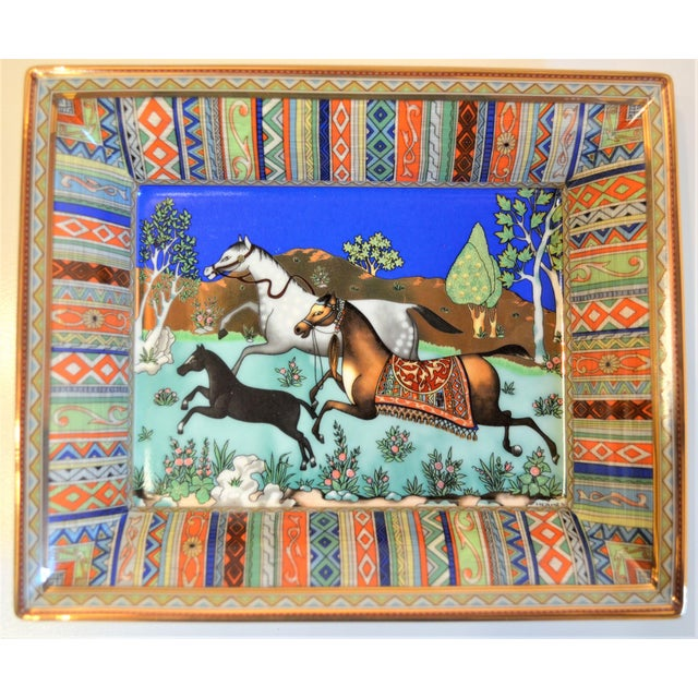 This is a vintage Hermes porcelain cigar tray circa 1970's. This tray features a horses running in the green with a...