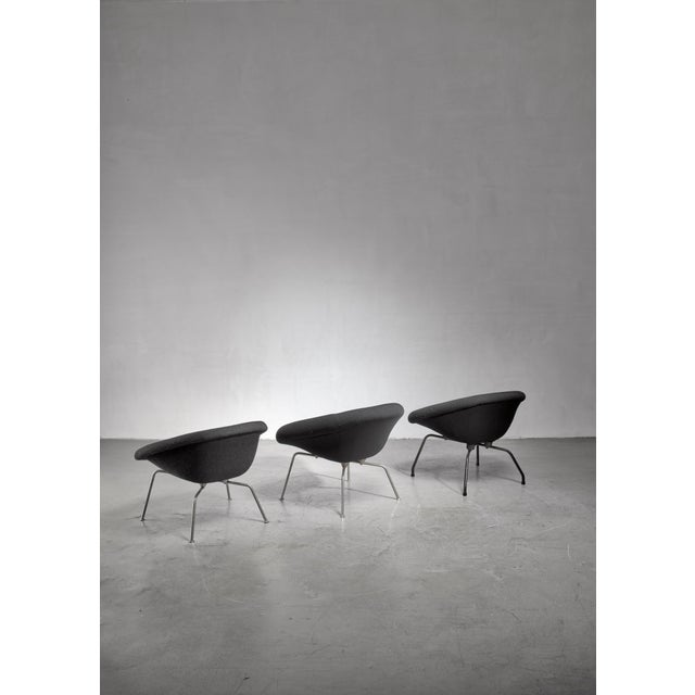A set of three mid-century Modern prototype chairs by Dutch engineer and architect Ing. J.G. Athmer. The chairs stand on a...