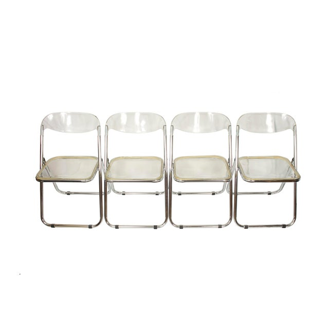 Great set of 4 Italian lucite folding chairs. The original Plia Folding Chair was designed by Giancarlo Piretti for the...