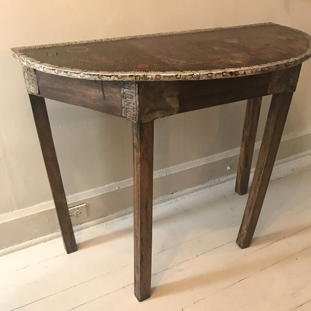 Brought to the states back in 1970's, made of wood and meted metal added on and embedded into the top