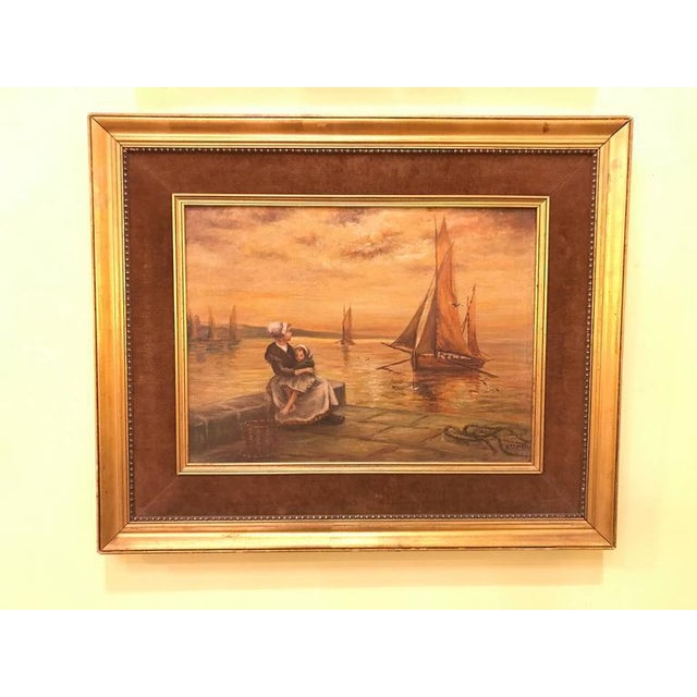 Oil on Canvas 19th Century Of a Woman And Child Sitting At The Pier. This finely detailed and popular scene sits in a gilt...