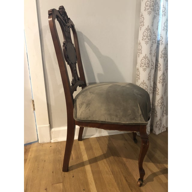 This chair attracted me with its intricate carving and mother of pearl inlay. Judging from the color and hardness of the...