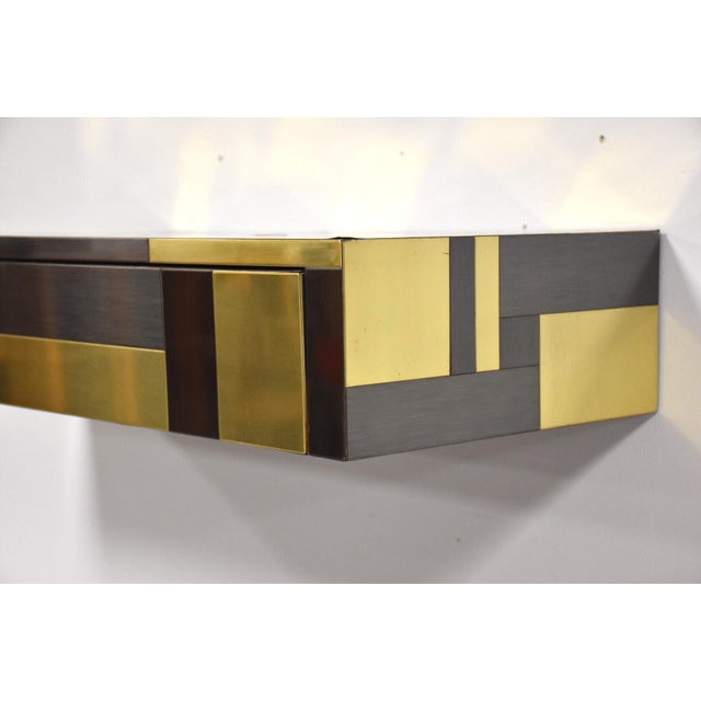 A mid century modern signed floating console table by Paul Evans for his Cityscape Collection with brass and gunmetal...