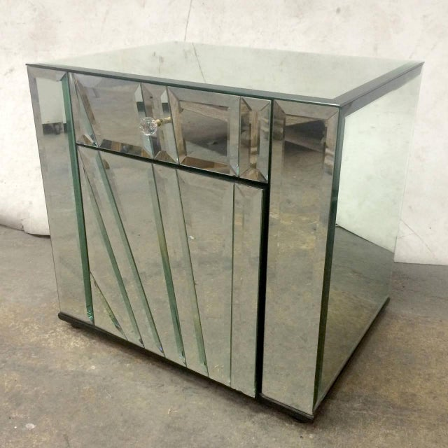 This pair of mirrored nightstands or side tables made by Ello is completely covered in reflective glass. Each nightstand...