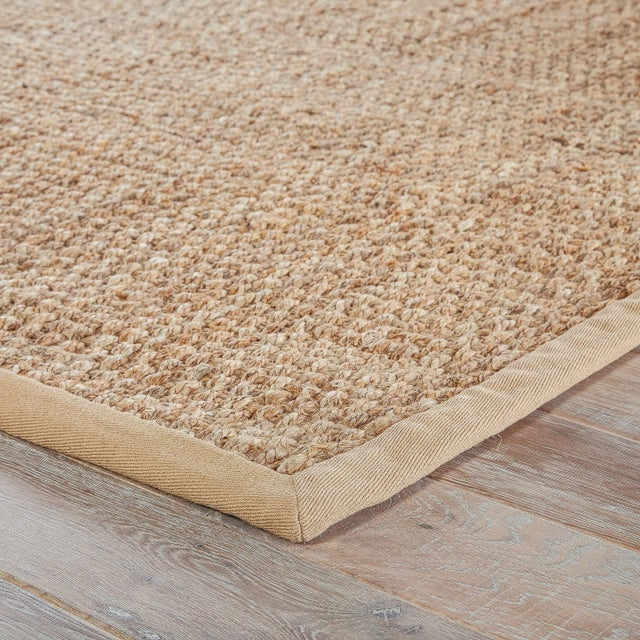 This hand-spun jute area rug offers a neutral foundation to transitional homes. Perfect for textile layering and coastal...