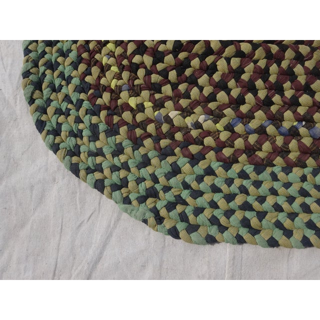 This is a antique hand woven Swedish oval Rag Rug
