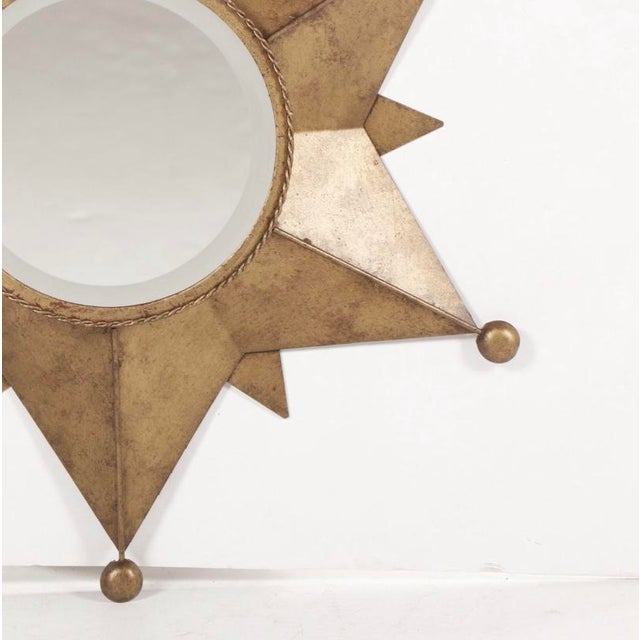 Beautiful accent mirror, made of metal and glass, very contemporary. Would look great in a office, Front Door area or All...