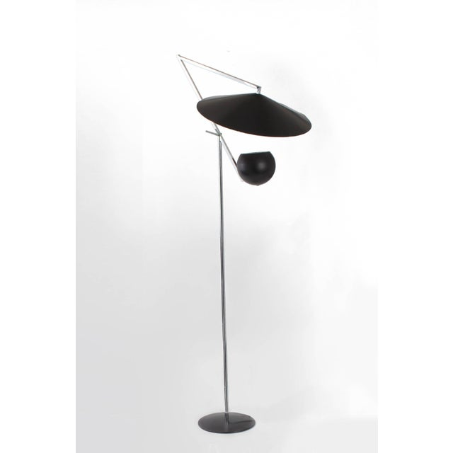 Bold, graphic articulated double-light floor lamp with adjustable head in nickel and painted metal, by modern light master...