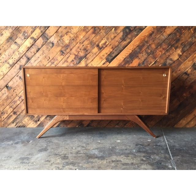 Mid Century Style Custom Walnut Sculpted Base Credenza newly built in Los Angeles, walnut wood, sliding doors with...