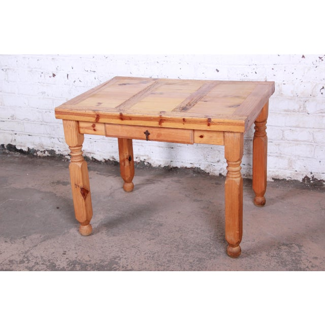 A gorgeous primitive rustic pine writing desk. The desk features solid wood construction and beautiful knotty pine wood...