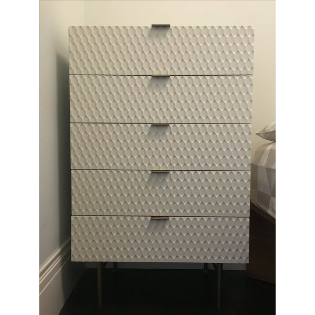 Just delivered to us on 9/20/16. Brand new, not yet used. With its geometric, textured drawer fronts and smooth lacquer...