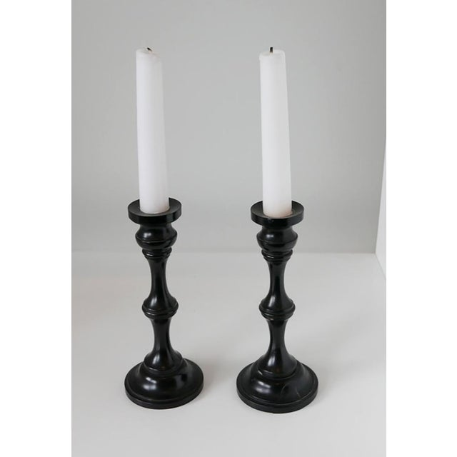 A stunning genuine pair of ebony candlesticks Since candles are not needed for house lighting now, they can be used on...