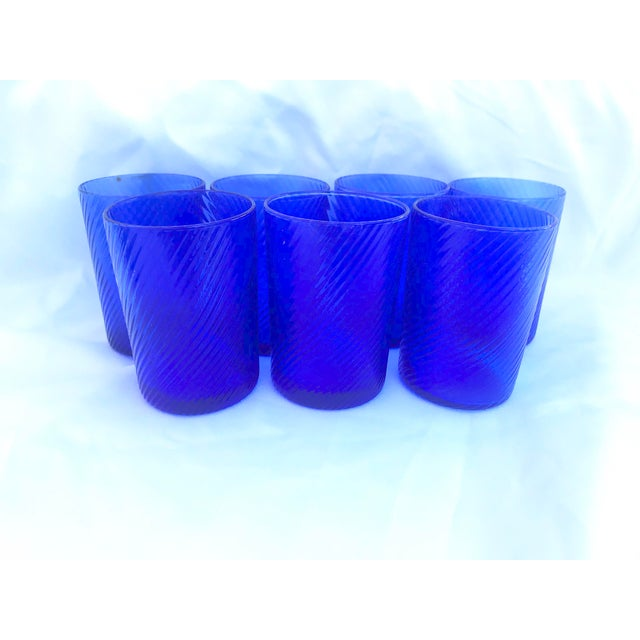 Beautiful set of 7 vintage glasses. In a striking royal blue color these are perfect to use for juice or water. Great for...