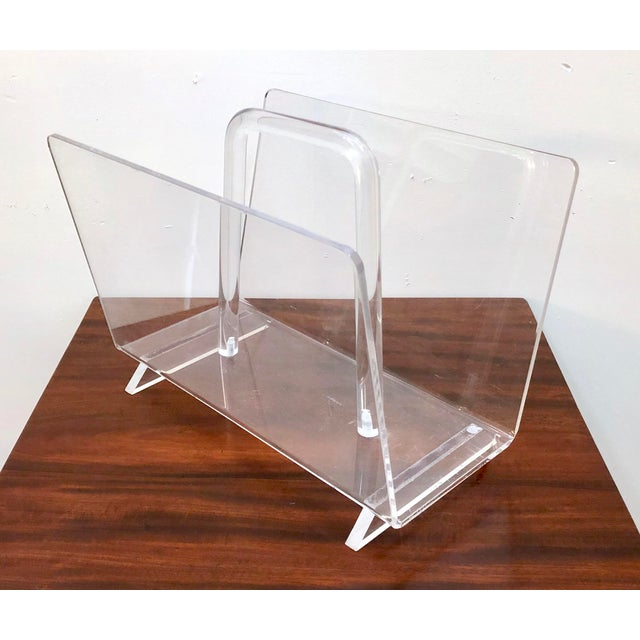 Nicely made and stylish vintage lucite magazine rack. We have 2 of these available, sold individually.