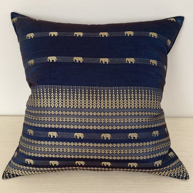 A beautiful blue Thai silk pillow with elephant and geometric motif design. 100% silk. Zipper on the back side of the pillow.