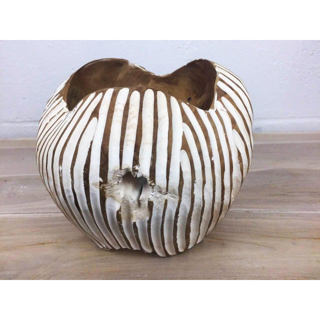 Wooden teak wood bowl, handcrafted from a fallen tree root. The bowl evokes an unique tribal vibe with its handpainted...