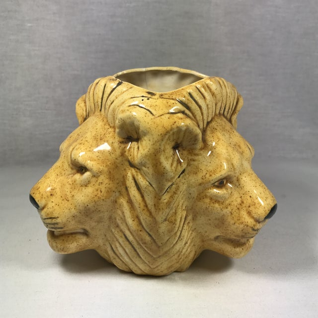 Vintage lion head vase or planter. Handmade with personalized message and date on the bottom. Features three lion faces....