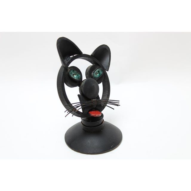 This is a whimsical Iron cat head. made of found objects unsigned and just irresistible. It is heavy and weights 2 pounds...