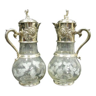 Pair of English Sliver Plated and Engraved Glass Claret Jugs For Sale