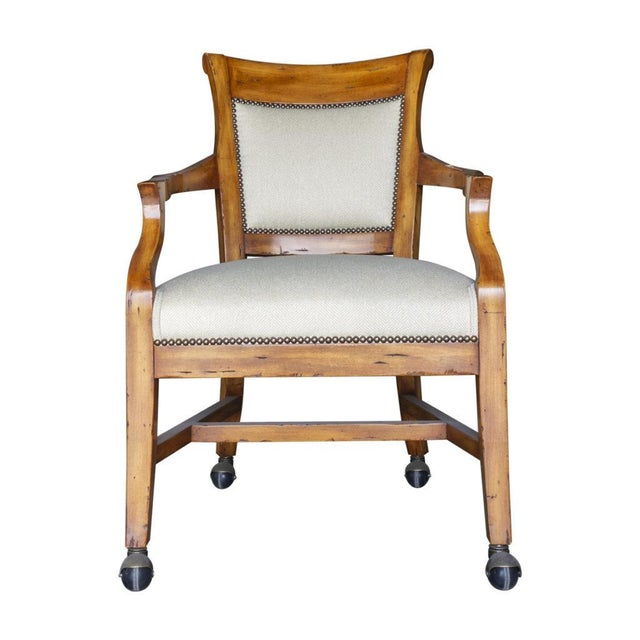 Featuring the Veranda game chair with nail heads and castors. Antique Tuscany finihs.