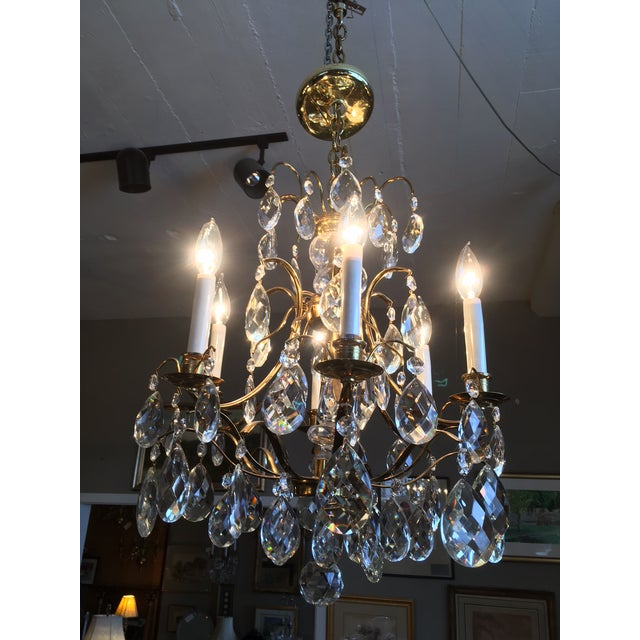 Beautiful, elegant, Marie Therese style solid brass and crystal six light chandelier. The crystal components are possibly...