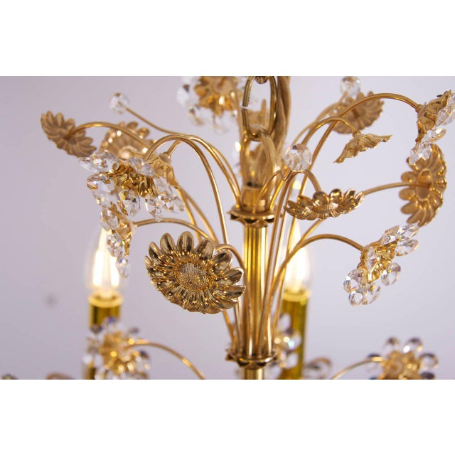 Very glamorous and large flower chandelier with hundreds of crystals in different sizes. Gold plated brass stunning...