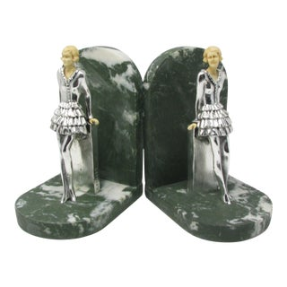 Vintage Art Deco Resin and Metal Bookends Featuring Lady Leaning on a Wall - a Pair For Sale