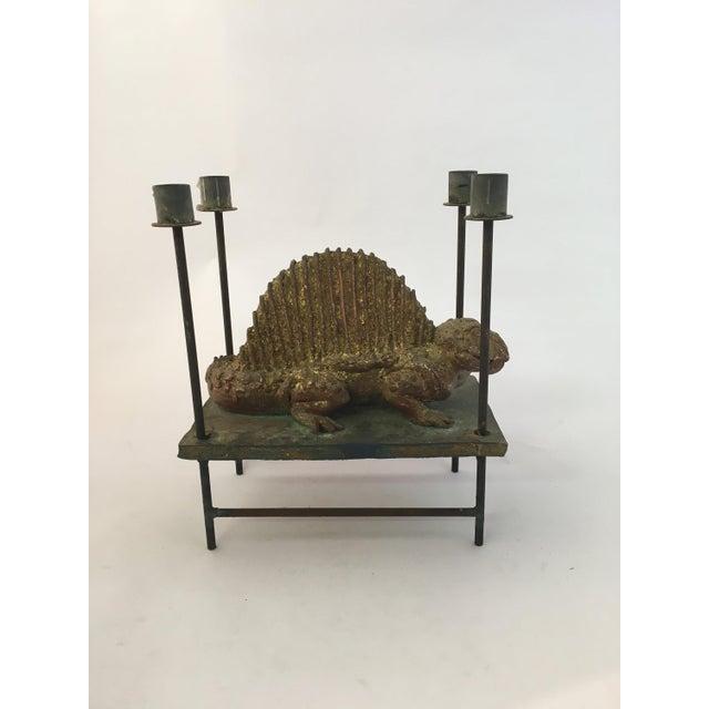 Fantastic signed Thoym Rebusi Studio Dimetrodon candleholder. The sculpture is made of gilt terra-cotta with an iron base...