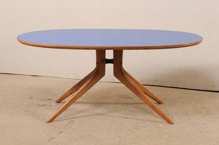 An Italian Midcentury Elliptical Table With Oval Shaped Blue Glass Top.  This Vintage Elliptical