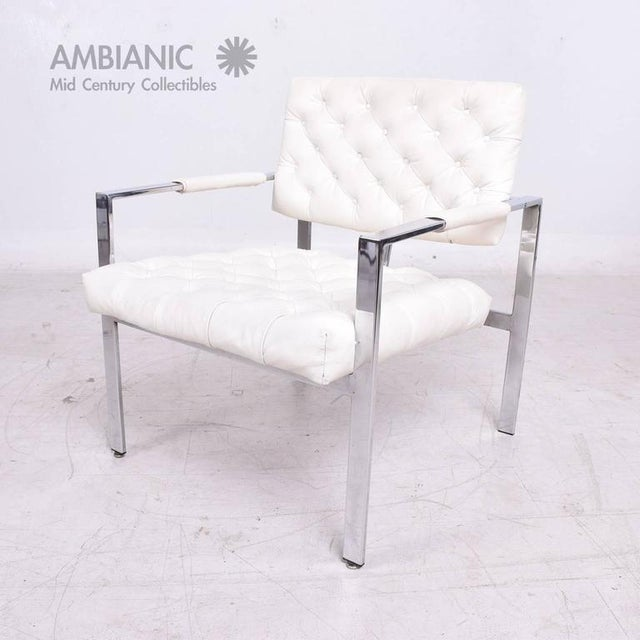 For your consideration a single armchair in chrome frame with original white naugahyde in tufted work. Chair retains...