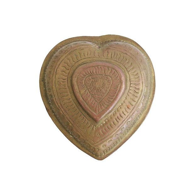 Offered is a lovingly hand-crafted solid brass heart shaped box. No maker's marks.
