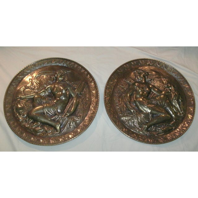 Set of three vintage hand embossed round metal wall art discs featuring characters from Greek mythology. Possibly copper,...