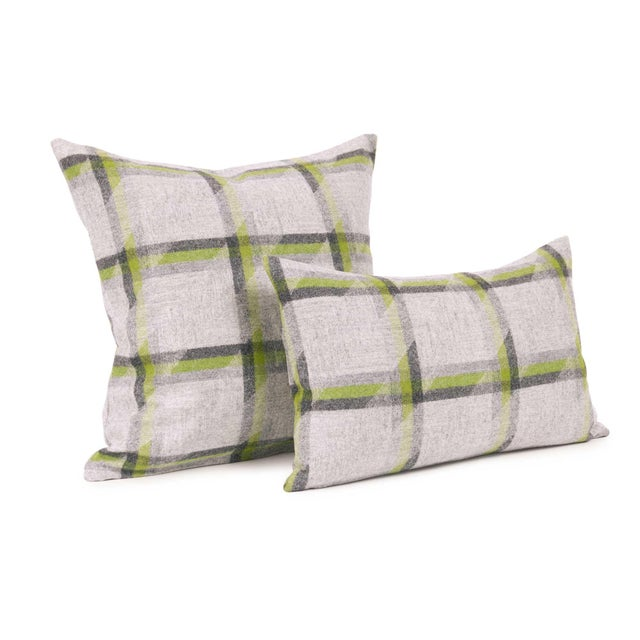 Our medium size throw and lumbar pillow covers in a beautiful Camira fabric. A clean grey overlaid with oversized plaid,...
