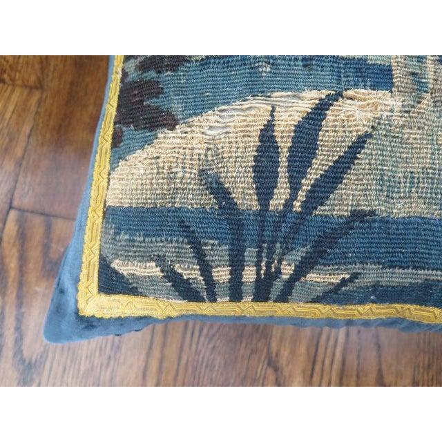 Custom 18th century verdure tapestry pillow in marine blue linen velvet and gold metallic trim. Down filled.