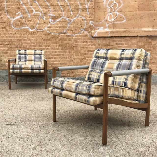 Pair of handsome, Mid-Century Modern, mahogany, club / lounge chairs feature semi attached cushions in their original...