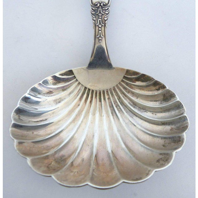 Offered is an elegant sterling silver scalloped berry spoon marked Buccellatti. In 1919 Mario Buccellati began his...