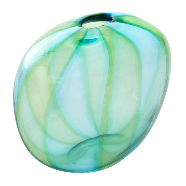 Hand-blown Murano glass trio. This dynamic Murano vessel trio combines swirling shades of aqua and green glass. We love...