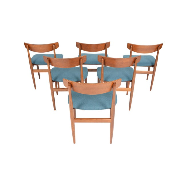 This set of six mid century dining chairs was designed by Ib Kofod- Larsen for G Plan's Danish Range in the 1960s. This...
