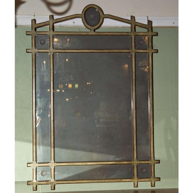 Featuring a grid-like frame that's been painted with gilt highlights, this Pier Mirror also features glass stars motifs at...